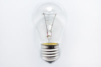 incandescent bulb lies on a white background