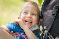 Close up portrait of cute little son hug cuddle laughing enjoying
