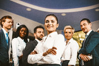 Business Lady Smiles Standing In Front Of Colleagues's Group