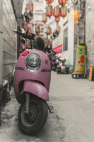 Pink scooter parked in Feng Huang Old Town