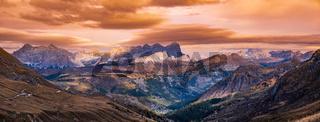 Autumn alpine Dolomites mountain dramatic sunset scene near Pordoi Pass, Trentino , Italy.