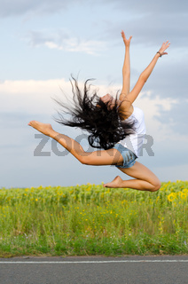 Athletic woman leaping in ballet pose
