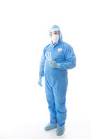 Healthcare worker in full PPE holding swabs for coronavirus pandemic