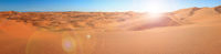 Big sand dunes panorama. Desert or beach sand textured background.
