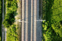 Flying over railway tracks, top view.