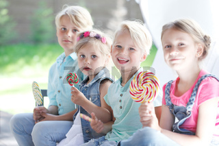 Happy children with lollipops