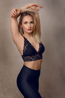 Sexy young blond woman in black lingerie