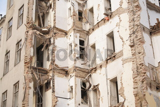 Old demolished multistory building with bricks and doorframes. Demolition, renovation, earthquake concept