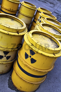 Radioactive warning symbol on tuns of toxic waste