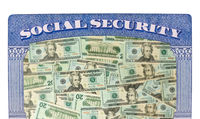 Many US dollar bills or notes inside Social Security framework as concept for funding crisis