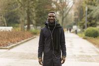 Young Black Man Looking at Camera on Park Road