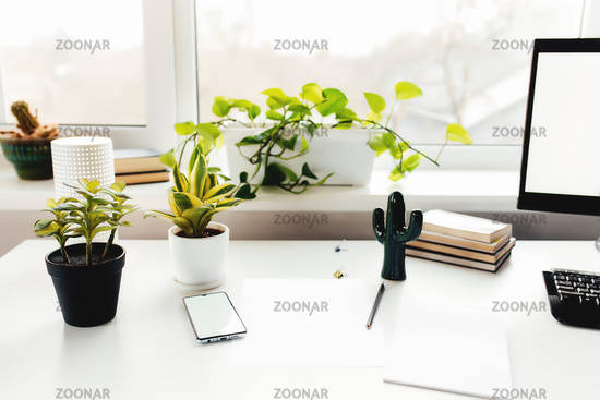 Smartphone on white table, work from home, office stuff