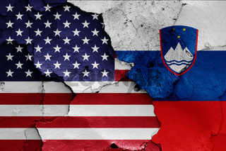 flags of USA and Slovenia painted on cracked wall