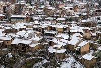 House rooftops covered in snow after snowstorm in winter. Kakopetria Troodos Cyprus