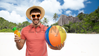 happy man with orange juice and beach ball