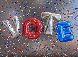 Shiny helium balloons with the word Vote and glittering confetti