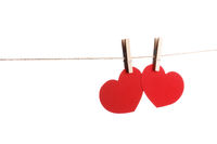 Clothes pegs and two red paper hearts