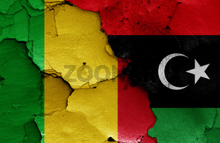 flags of Mali and Libya painted on cracked wall