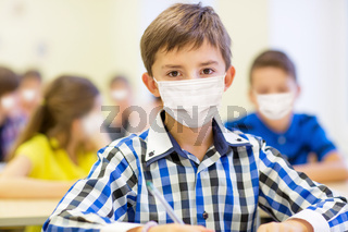 student boy in protective medical mask at school