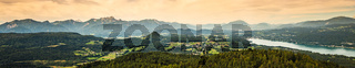 Panorama of Alpine mountains near Lake Worthersee and Velden city