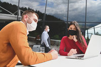 business people wearing protective mask