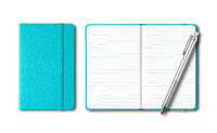 Aqua blue closed and open notebooks with a pen isolated on white