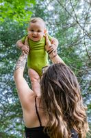 Mother and baby son, outdoor portraits