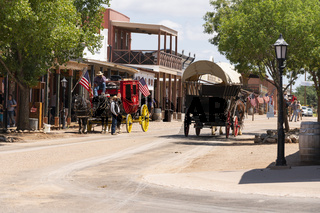 Tombstone, Arizona/USA- August 24, 2019: Horse Drawn Coaches and Wagons pull Visitors around Town in Tombstone, Arizona USA