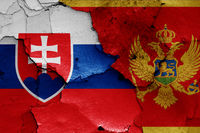 flags of Slovakia and Montenegro painted on cracked wall