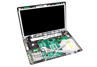 Laptop disassembled with wrench on it