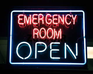 Open neon or led sign of an emergency room illuminated at night in America