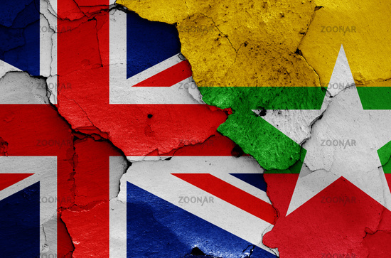 flags of UK and Myanmar painted on cracked wall