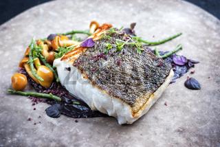 Gourmet fried European skrei cod fish filet with glasswort