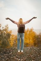 Happy Woman Stands On Mountain Outstretched Her Arms