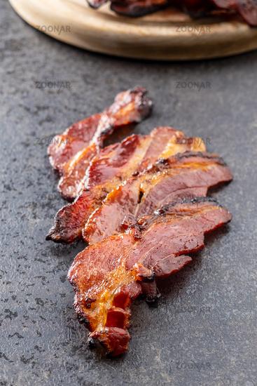 Fried bacon. Sliced roasted bacon.