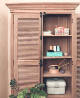 Sewing accessories in retro wooden cupboard
