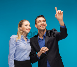 man and woman working with something imaginary