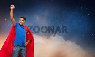 indian man in superhero cape over night sky