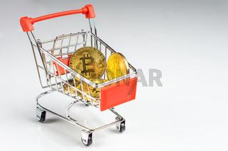 Bitcoin coins in a shopping cart