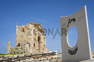 Gerasa, Jerash, Jordan: entrance of the historical roman ruins site of Gerasa in Jerash, Jordan, with the Arch of Hadrian in the background