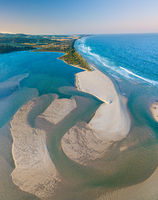 Aerial view of sand patterns in the shallow waters of the ocean inlet