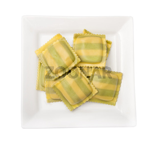 Fresh  ravioli with spinach and cheese on white background