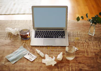 Medications on table near laptop
