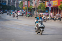 Older man riding on a scooter in Yangshuo