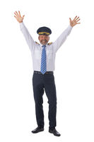 Airline pilot with arms raised