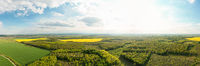 Scenic landscape of countryside from bird's eye view, springtime. Aerial drone view of woodland and farmland