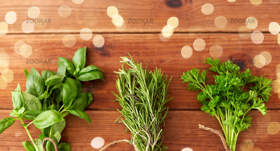 greens, spices or medicinal herbs on wooden boards