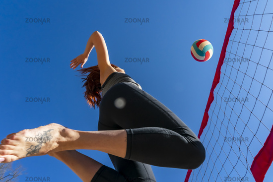 A Gorgeous Redhead Fitness Model Preparing To Play Volleyball