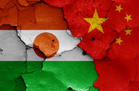 flags of Niger and China painted on cracked wall
