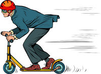 A businessman is riding a scooter